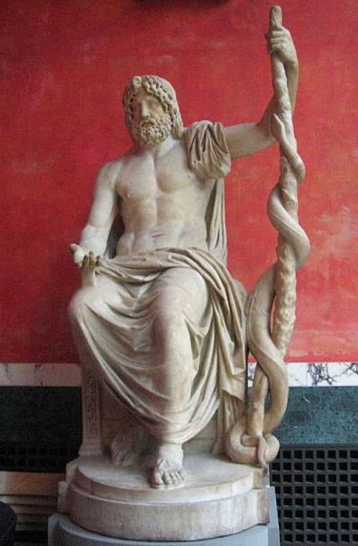 Statue of Asclepius, the Greek god of medicine, holding the symbolic Rod of Asclepius with its coiled serpent