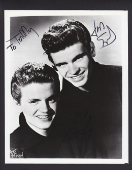 This is a signed copy of a promotional shot used by the Everly Brothers around 1958.