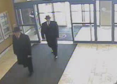 Footage of MIB on a hotel lobby camera.