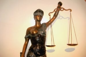 Justice is supposed to be blind...meaning impartial and fair, not influenced by outside sources.
