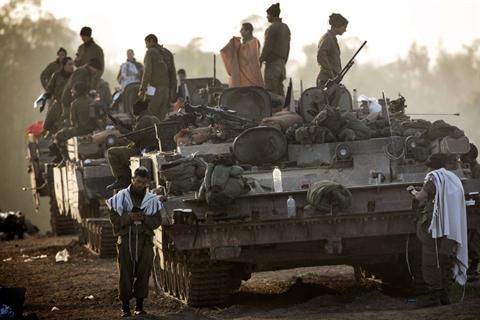 "Israeli soldiers wearing ""Talit"" (prayer shawls) conduct morning prayers at an Israeli army deployment area near the Israel-Gaza Strip border on November 20, 2012 Read more: http://www.dailystar.com.lb/News/Middle-East/2012/Nov-20/195685-israel-army"