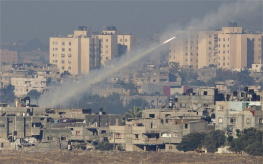 A rocket launched by Palestinian militants towards Israel makes its way from the northern Gaza Strip, seen from the Israel Gaza Border, southern Israel