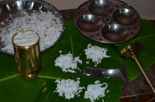 idiyappam is usually made in the same vessel used to cook Idli.. you may either directly put coconut scrapping and start making idiyappam.