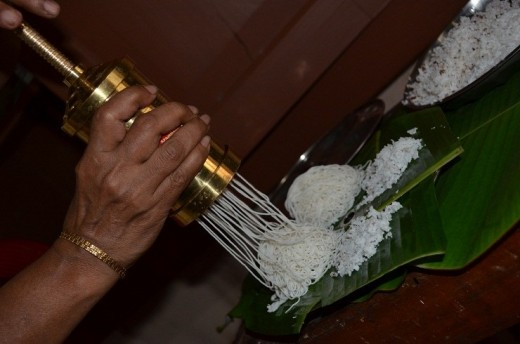 Now add the dough in the idiyappam maker and squeeze in circular way so that you get the shape of idiyappam.
