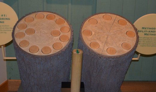Round billets are cut from ash and maple logs to be turned into bats.