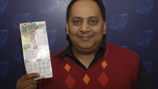 Khan happily displays his winning ticket