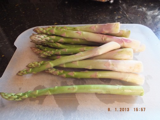 Wash the asparagus and just snap off the bottoms with your hands. It will snap off where it is beginning to lose its fibrousness.