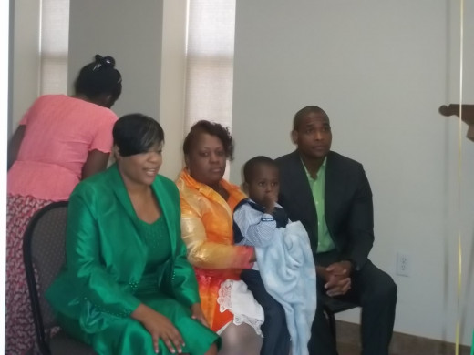 First Lady Min. Vernanda McKnight, Sis. Cheryl Watkins (nephew CJ), Pastor Bishop Marcus D. McKnight