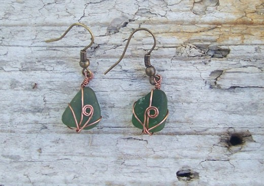 green sea glass earrings.