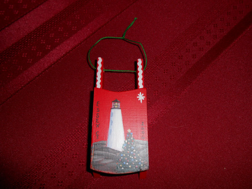 A Christmas tree ornament from one of our favorite local towns, with a lighthouse, one of my husband's favorite things!