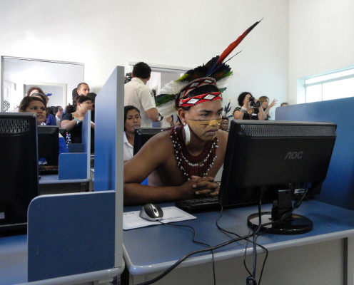 Young Brazilian man checks out the new computer center in Cabrália, Brazil. The center provides broadband access, 3G mobile Internet, and custom applications for managing fishing businesses, equipment, and training.
