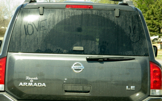 Love in the air--even on a dirty car.