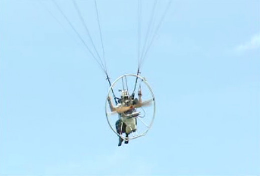 The motor attached to the Paramotor Pilot's back is a customized motor of a motorcycle
