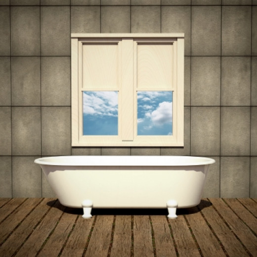 Direction of tiling can make the bathroom look bigger.  Source Sira Anamwong @ freedigital photos.net.
