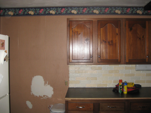 Backsplash complete, the rest of the kitchen...not so much.