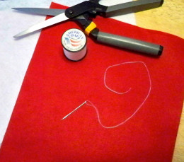 Red and white felt, or needed colors to fit projects for other holidays.
