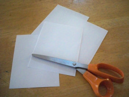 Fold and cut the paper into quarters, then eighths to use for making various patterns.