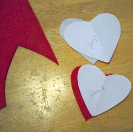 Cut one large heart from the felt that will be your back piece (in this case the white), and one smaller heart from the felt that will be the front piece of your project (in this case the red).