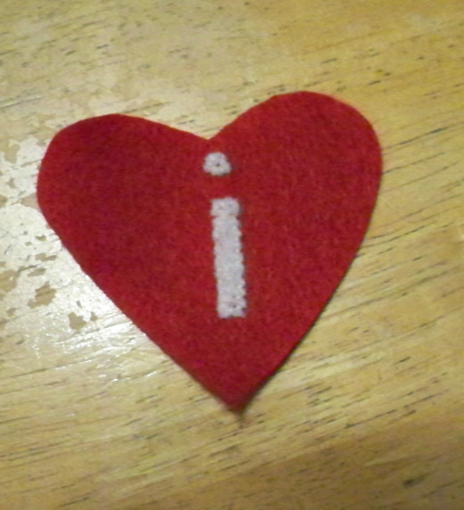 Position and sew the cut out design to the smallest piece/red heart.