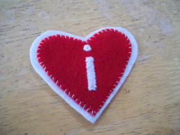 Sew the smaller front piece/red heart to the larger back piece/white heart.