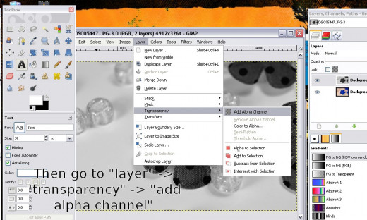 "Next, you'll need to create an ""alpha channel"" by going to ""layer"" then ""transparency"" then ""alpha channel."""