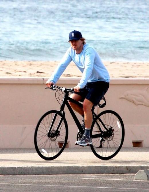 Owen Wilson pedals his way along the California coast.