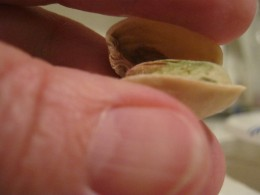 Twist it like you are twisting a screwdriver and hear the nut pop open. Easy! Now there's no reason to leave those partially opened difficult ones for someone else to deal with when you're eating pistachio's. Not that I ever did that...