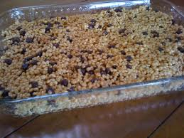 After the Rice Krispie mixture has cooled a little mix in your chocolate chips and pour into a greased casserole dish.