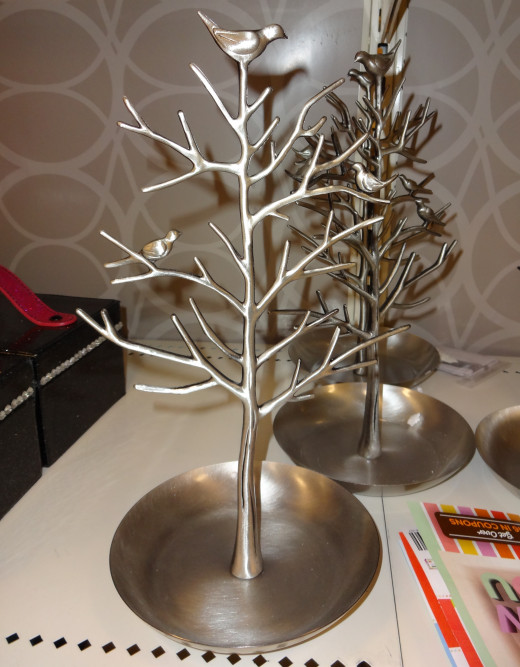 If you're buying any jewelry or if your mom already has a lot of jewelry, this tree will hold and display it for her.
