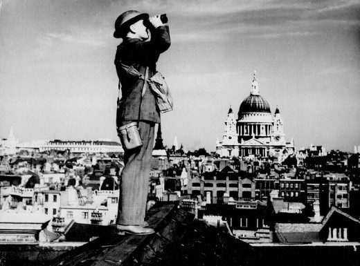 A member of the Observer Corps keeps a close eye on the skies of London during the Battle of Britain..