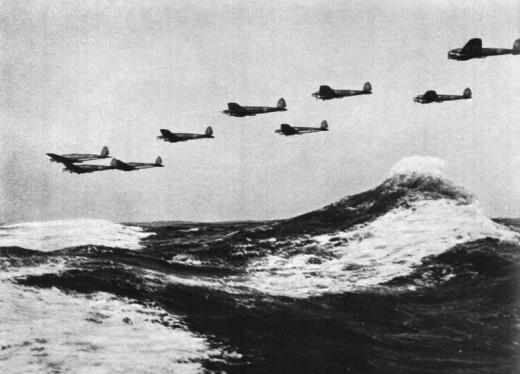 A formation of German Heinkel He-111 bombers flying low over the English Channel.