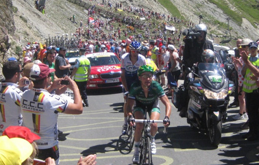Thomas Voeckler leading the field in the Tour de France over the Col du Tourmalet in 2012.  His arms are not huge, but you can see that they have clear strength definition from an upper body routine.