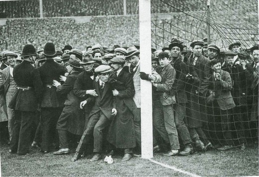 Supporters flood the pitch in the 1923 F.A. Cup final.