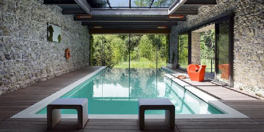 Indoor swimming pool with skylights and wood trims