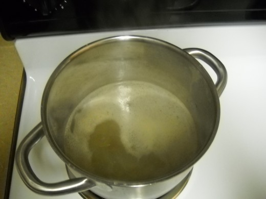 Boiling water with broth cubes