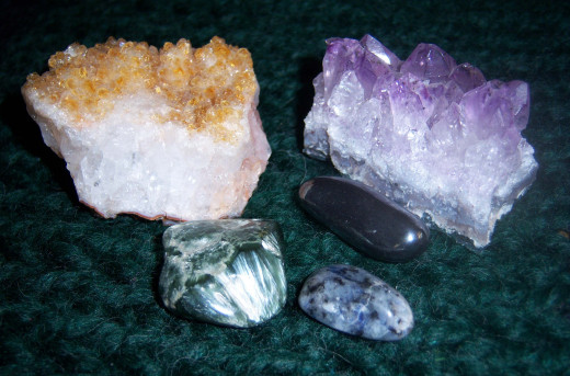 Clockwise, starting from the upper left corner: Citrine, Amethyst, Hematite, Soladite and Seriphanite. These were all purchased at various shops.