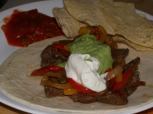 Guacamole is often served on fajitas,