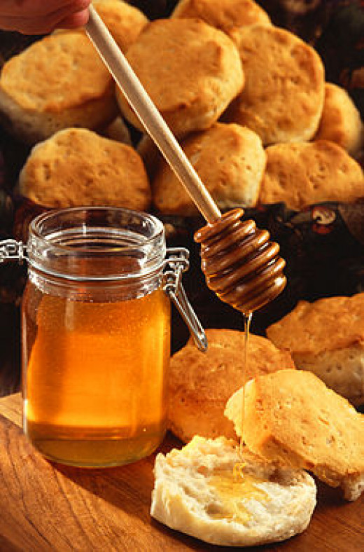 .A jar of honey with honey dripper.