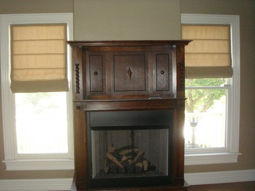 AFTER A gas fireplace box to house the antique mantle makes this den warm and cozy.