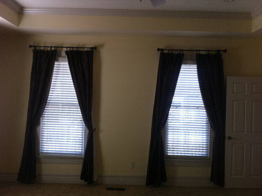 BEFORE Small wall space between windows in master bedroom.
