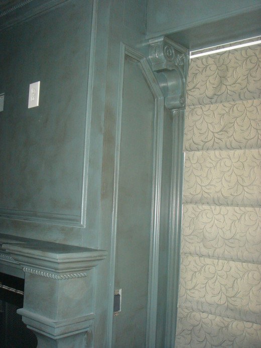 AFTER This closer view shows the antiquing on the unusual paint color and the detail of the corbels and braid woodwork.