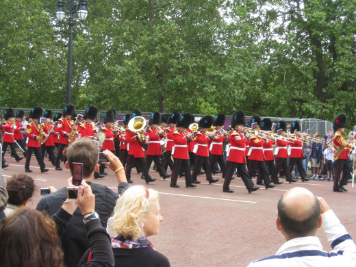 Don't go to Buckingham Palace, go to where they start their procession: a much better experience.