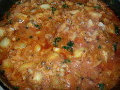 Crisp Fried Potatoes and Cauliflower in Rich creamy Onion and Tomato Sauce