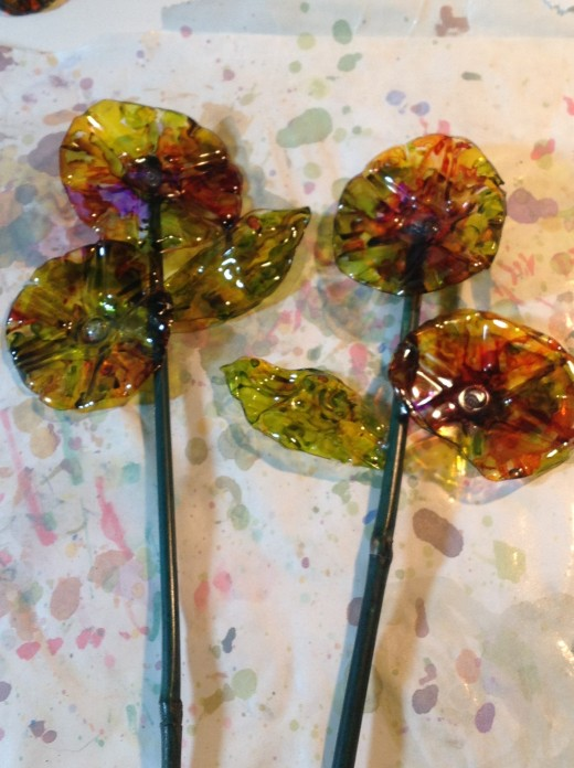 My lollipop flowers are made with the bottom of a water bottle.