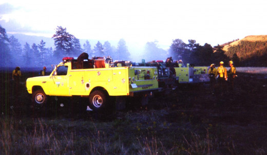 Additional resources arriving at dusk for extended attack, the fire is not yet contained.