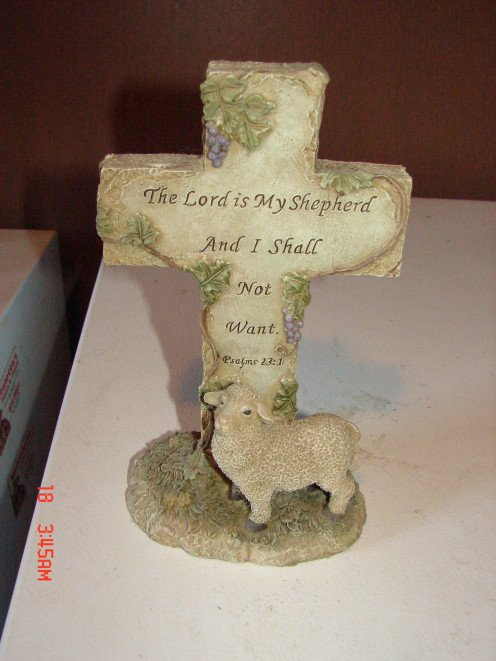 This is a picture of a lamb standing in front of a cross.  It is great to decorate with especially in a Christian home.