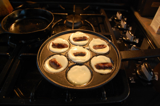 adding the sausage into the middle of the puff