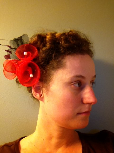 Smaller fascinators look great with this hairstyle.