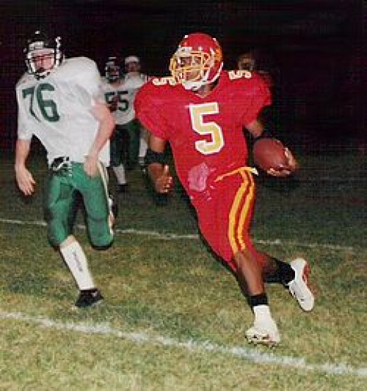 A running back sweeping left end during a high school game near Cincinnati in 1999.