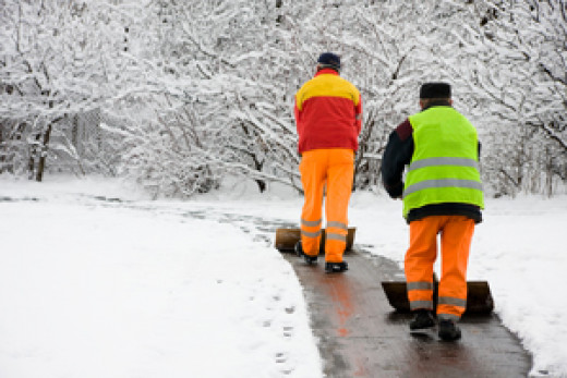 Men clearing first snowfall